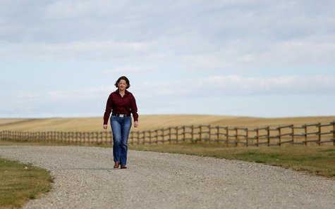 Alberta Premier Alison Redford arrives to discuss the E. coli outbreak with cattle ranchers at the Bell L ranch near Airdrie, Alberta, Septe