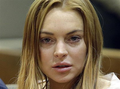 Actress Lindsay Lohan sits at a hearing in Los Angeles Superior Court in Los Angeles, California March 18, 2013. REUTERS/Reed Saxon/Pool