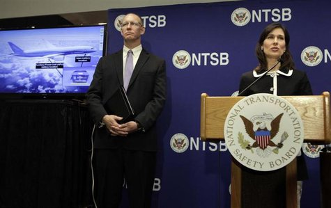 National Transportation Safety Board (NTSB) Chairman Deborah Hersman speaks next to John DeLisi, director of the NTSB Office of Aviation Saf