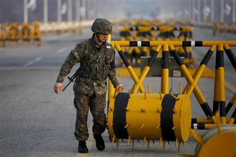 A South Korean soldier sets up a barricade at a checkpoint on the Grand Unification Bridge, which leads to the demilitarized zone separating