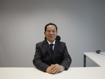Universal Entertainment Corporation CEO Kazuo Okada poses during an interview in Hong Kong October 30, 2012. REUTERS/Bobby Yip
