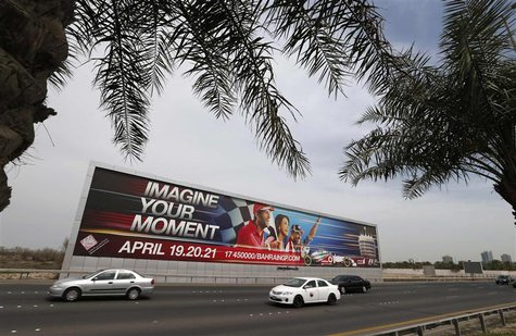 Vehicles travel past a large Bahrain Formula One advertising billboard on main highway leading to Bahrain Internaitonal Circuit, in Manama A