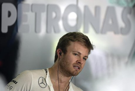 Mercedes Formula One driver Nico Rosberg of Germany looks on in the garage during the first practice session of the Malaysian F1 Grand Prix