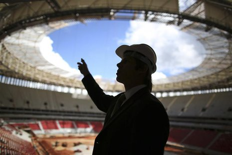 A worker is seen at the National Mane Garrincha Stadium undergoing construction in Brasilia April, 8, 2013. REUTERS/Ueslei Marcelino