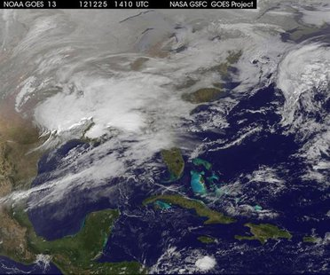 Storm clouds are seen on the east coast of the United States in this NASA handout satellite image taken at 1415 GMT, December 25, 2012. REUT