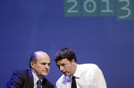Italian PD (Democratic Party) leader Pierluigi Bersani (L) speaks with mayor of Florence Matteo Renzi during a political rally in Florence F
