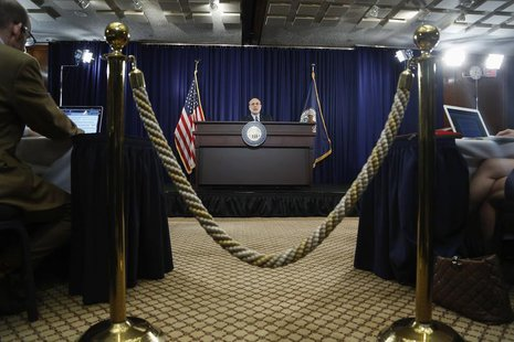 Federal Reserve Board Chairman Ben Bernanke takes the stage for a news conference at the Federal Reserve offices in Washington, March 20, 20