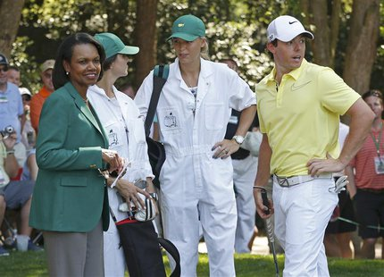 Former U.S. Secretary of State and new member of Augusta National Golf Club, Condoleezza Rice (L) stands with Northern Ireland's Rory McIlro
