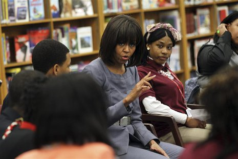 First Lady Michelle Obama is shown in this handout photo provided courtesy of the Chicago Tribune as she talks with students about the plagu