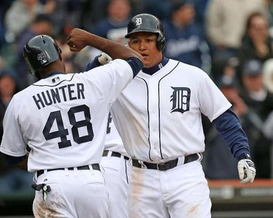 Detroit Tigers 3B Miguel Cabrera (R) is congratulated by RF Torii Hunter following his fourth-inning homer in Detroit's 7-3 victory over Toronto at Comerica Park on Apr. 9, 2013. (photo courtesy Detroit Tigers)