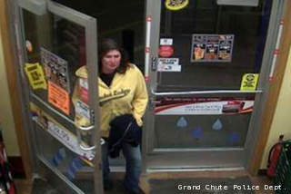 Grand Chute police are working to identify a woman suspected of robbing a convenience store on Sunday, April 7, 2013.