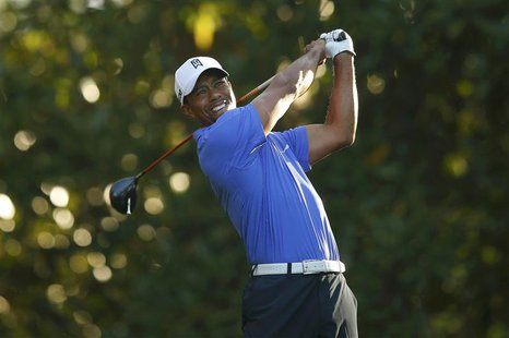 Tiger Woods of the U.S. hits his tee shot on the 11th hole during a practice round in preparation for the 2013 Masters golf tournament at th