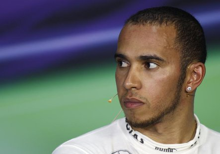 Mercedes Formula One driver Lewis Hamilton of Britain attends a post race news conference after the Malaysian F1 Grand Prix at Sepang Intern