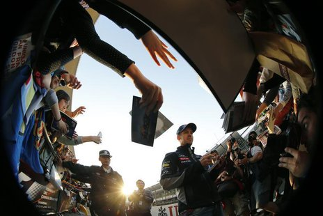 Red Bull Formula One driver Sebastian Vettel (C) of Germany signs his autograph at the Chinese Grand Prix at the Shanghai International Circ