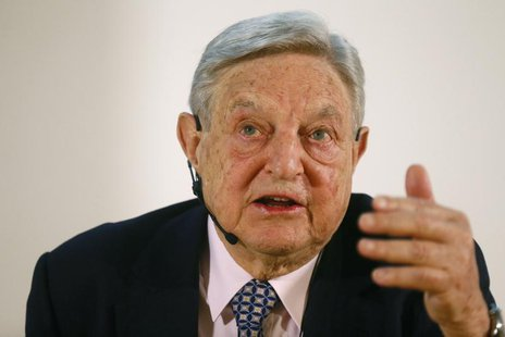 George Soros, Chairman of Soros Fund Management LLC gestures as he addresses the audience during an economic speech in Frankfurt April 9, 20