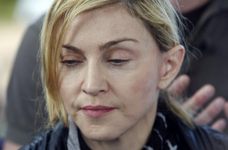 Madonna during a visit to Gumulira village, about 80 km (50 miles) from the Malawian capital Lilongwe, April 5, 2010. REUTERS/Mike Hutchings