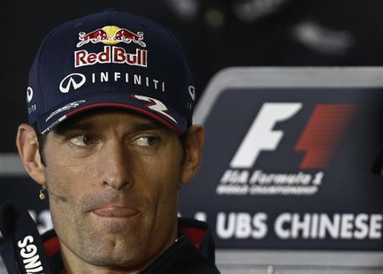Red Bull Formula One driver Mark Webber of Australia attends a news conference at the Chinese F1 Grand Prix at the Shanghai International Ci