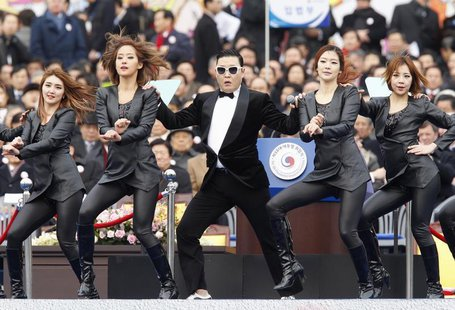 Singer Psy (C) performs during the inauguration of South Korea's President Park Geun-hye (not pictured) at the parliament in Seoul February