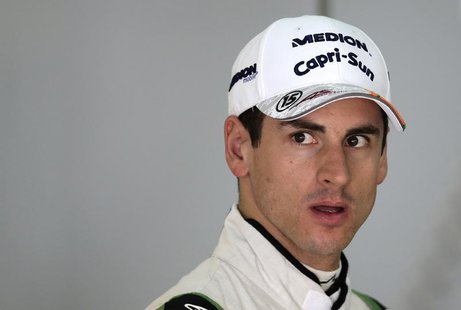 Force India Formula One driver Adrian Sutil of Germany walks in the garage during the first practice session of the Malaysian F1 Grand Prix