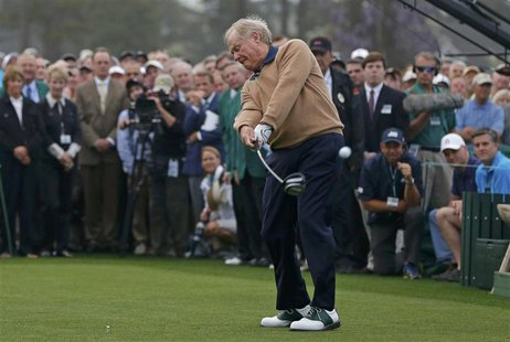 Jack Nicklaus of the U.S. hits his tee shot during the ceremonial start for the 2013 Masters golf tournament at the Augusta National Golf Cl