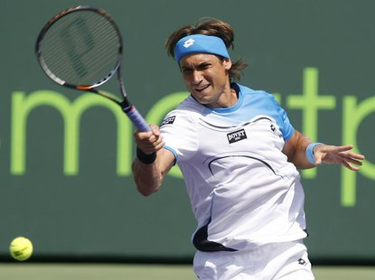 Spain's David Ferrer returns a shot Britain's Andy Murray in their men's singles final match at the Sony Open tennis tournament in Key Bisca