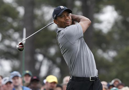 Tiger Woods of the U.S. hits his tee shot on the first hole during first round play in the 2013 Masters golf tournament at the Augusta Natio