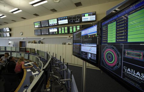 Technicians look at computer screens during the preparation of the beam in the Control Room of the Large Hadron Collider (LHC) at the Europe
