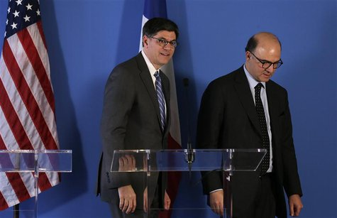 French Finance Minister Pierre Moscovici (R) and U.S. Treasury Secretary Jack Lew leave at the end of their joint news conference after a me