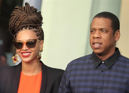 U.S. singer Beyonce (L) and her husband rapper Jay-Z walk as they leave their hotel in Havana in this April 4, 2013 file photo. REUTERS/Enri
