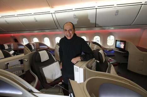 Qatar Airways CEO Akbar Al Baker poses for a photograph in the business class cabin of the new Boeing 787 Dreamliner after it arrived on it'