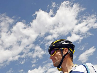 Astana rider Lance Armstrong of the U.S. awaits the start of the 19th stage of the 96th Tour de France cycling race between Bourgoin-Jailleu