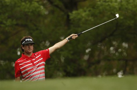Defending champion Bubba Watson of the U.S. gestures after hitting his tee shot on the fourth hole during first round play in the 2013 Maste