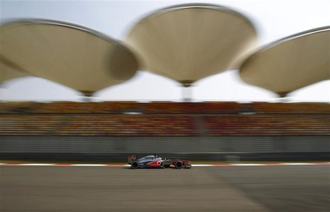 McLaren Formula One driver Jenson Button of Britain drives during the first practice session of the Chinese F1 Grand Prix at the Shanghai In