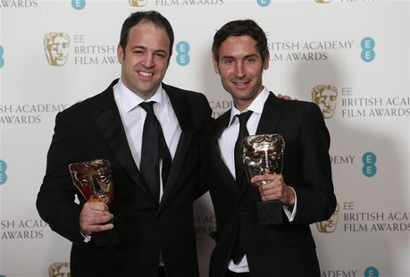 "Simon Chinn (L) and Malik Bendjelloul celebrate winning Best Documentary award for ""Searching for Sugar Man"" at the British Academy of Film"