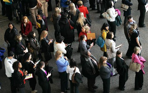 Hundreds of job seekers wait in line with their resumes to talk to recruiters at the Colorado Hospital Association health care career fair i