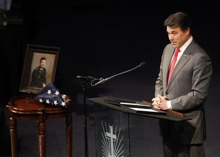 Texas Governor Rick Perry speaks at a memorial service for Kaufman County district attorney Mike McLelland and his wife Cynthia in Sunnyvale