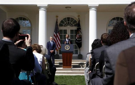 U.S. President Barack Obama talks about the Fiscal Year 2014 Budget while standing next to acting Director of Office of Management and Budge