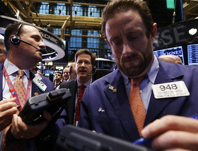 Traders work on the floor at the New York Stock Exchange, April 12, 2013. REUTERS/Brendan McDermid
