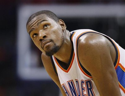 Oklahoma City Thunder forward Kevin Durant looks up at the scoreboard against the New York Knicks late is the fourth quarter of their NBA ba