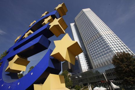 A huge Euro logo is pictured past the headquarters of the European Central Bank (ECB) in Frankfurt, September 29, 2011. REUTERS/Ralph Orlows