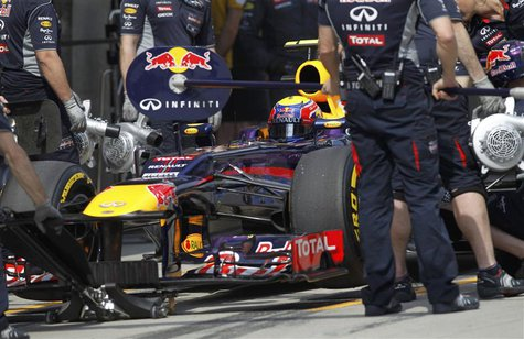 Red Bull Formula One driver Mark Webber of Australia stops in the pit lane during the qualifying session for the Chinese F1 Grand Prix at th