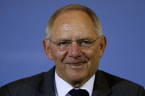 Germany's Finance Minister Wolfgang Schaeuble smiles as he addresses a news conference in Berlin March 25, 2013. REUTERS/Fabrizio Bensch