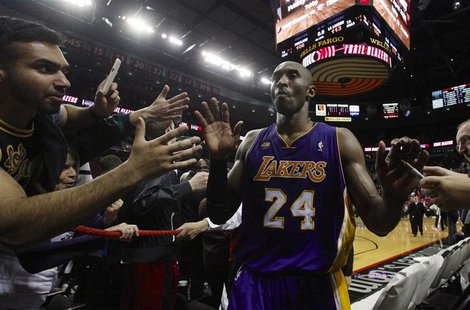 Los Angeles Lakers shooting guard Kobe Bryant (24) leaves the court after scoring 47 points against the Portland Trail Blazers after their N
