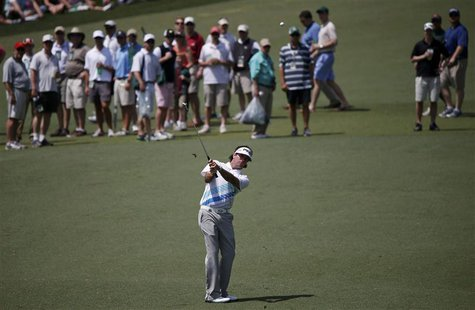 Defending champion Bubba Watson of the U.S. chips to the second green during second round play in the 2013 Masters golf tournament at the Au