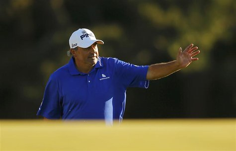Angel Cabrera of Argentina waves as he walks onto the 18th green during third round play in the 2013 Masters golf tournament at the Augusta