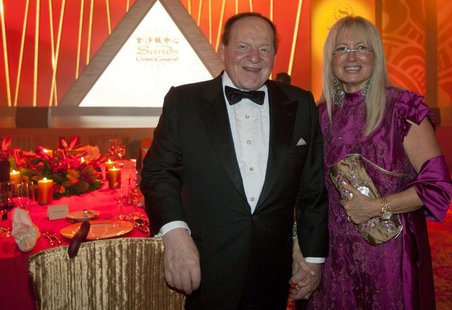 Las Vegas Sands Chairman and CEO Sheldon Adelson and his wife Miriam Ochsorn (R) pose for a photo during the opening ceremony of Sheraton Ma