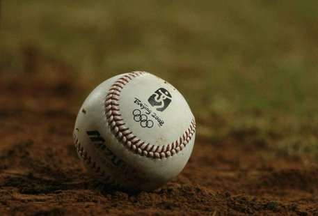 A baseball with the Olympic logo lies on the field during the U.S.-China baseball game at the Beijing 2008 Olympic Games August 18, 2008. RE