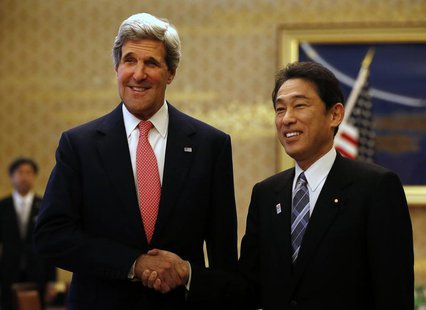 U.S. Secretary of State John Kerry (L) shakes hands with Japan's Foreign Minister Fumio Kishida during their meeting at the Iikura Guest Hou