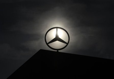 The logo of Mercedes Benz is seen on top of a car factory against the background of an overcast sky in the central Hungarian town of Kecskem
