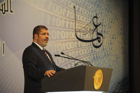 Egypt's President Mohamed Mursi speaks during an event marking Science Day in Cairo April 11, 2013 in this picture provided by the Egyptian